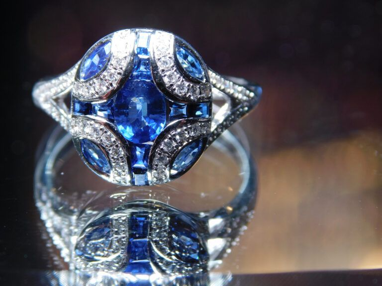 A large blue stone ring with diamonds