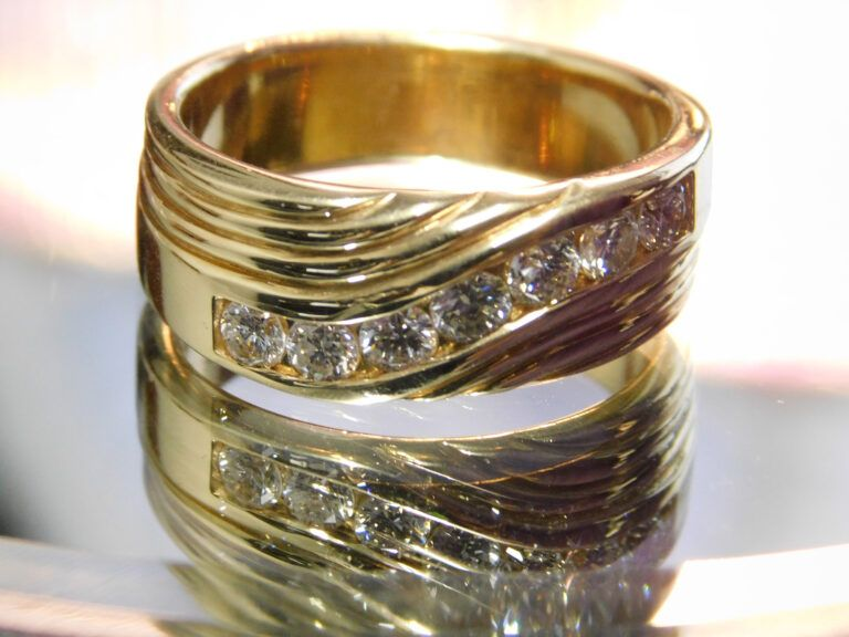A gold band mens ring with diamonds