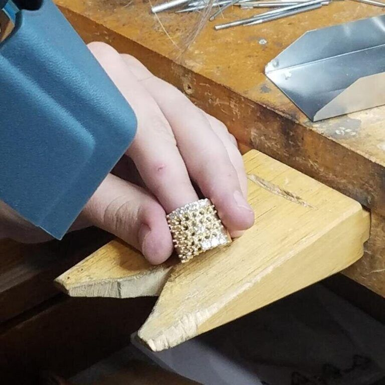 Inspecting a large gold ring