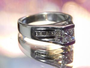 A silver diamond ring