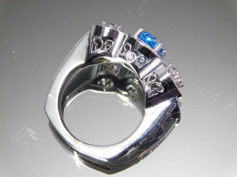 side view of a three stone white gold diamond and Tanzanite ring